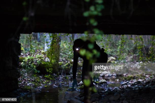 Biological Researcher Researching under a Bridge