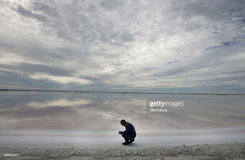 Biologist Fernando Heredia inspects the quality of a crystallization pond at the Exportadora de Sal (ESSA) harvest fields in Guerrero Negro, Mexico, on Wednesday, Jan. 24. 2013. Exportadora de Sal (ESSA), a joint venture between Fidecomiso Mining Development Corporation and Mitsubishi, is one of the leading producers and suppliers of salt for the chlorine-alkali industry in the Pacific Rim. Photographer: Susana Gonzalez/Bloomberg via Getty Images