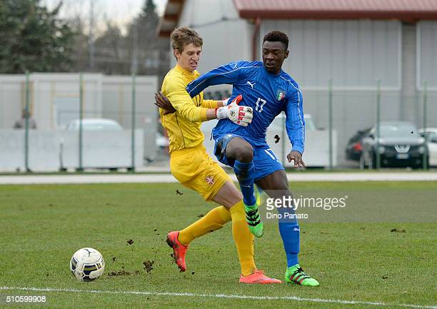 Bioty Moise Kean of Italy U17 competes with Aleksander Popovic goalkeeper of Serbia U17during the international friendly match between Italy U17 and...