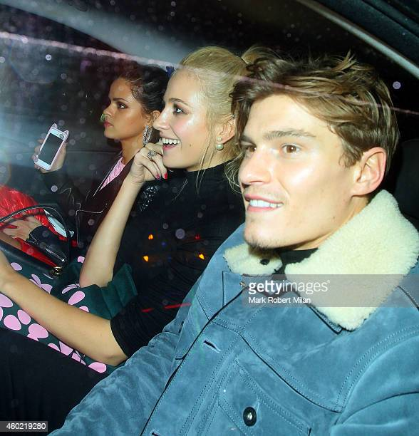 Bip Ling Oliver Cheshire and Pixie Lott attending The Sunday Times Style Christmas party at Tramp night club on December 9 2014 in London England