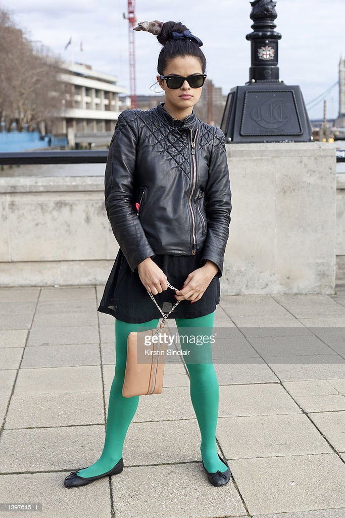 KINGDOM - FEBRUARY 21 Bip Ling wearing a Mc Q jacket, Topshop tights and shoes, Kurt Geiger bag, Jenny Davidson skirt and Ray Ban sunglasses street style at London fashion week autumn/winter 2012 womenswear shows on February 21, 2012 in London, England.