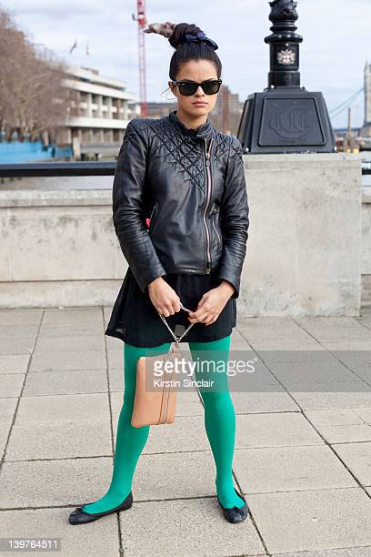 KINGDOM FEBRUARY 21 Bip Ling wearing a Mc Q jacket Topshop tights and shoes Kurt Geiger bag Jenny Davidson skirt and Ray Ban sunglasses street style...