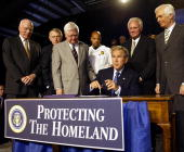 Bipartisan congressional leaders stand behind US President George W Bush as he prepares to sign the 30 billion USD Homeland Security Appropriations...