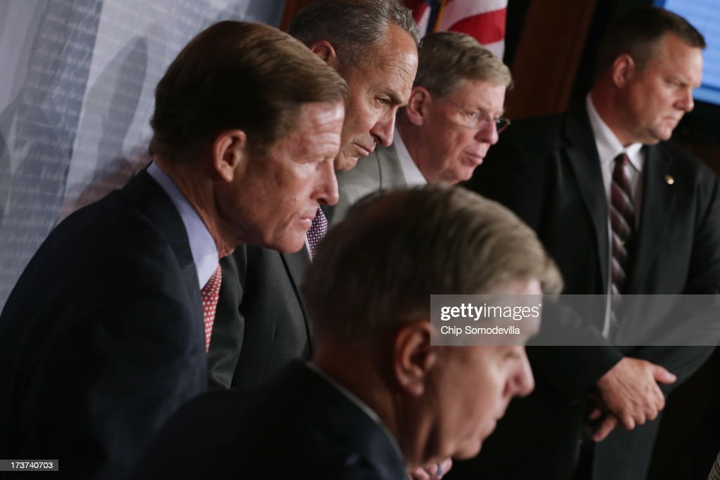 A bipartisan group of Senators, including U.S. Sen. <a gi-track='captionPersonalityLinkClicked' href=/galleries/search?phrase=Lindsey+Graham&family=editorial&specificpeople=240214 ng-click='$event.stopPropagation()'>Lindsey Graham</a> (R-SC), U.S. Sen. <a gi-track='captionPersonalityLinkClicked' href=/galleries/search?phrase=Richard+Blumenthal&family=editorial&specificpeople=1036916 ng-click='$event.stopPropagation()'>Richard Blumenthal</a> (D-MA), U.S. Sen. <a gi-track='captionPersonalityLinkClicked' href=/galleries/search?phrase=Charles+Schumer&family=editorial&specificpeople=171249 ng-click='$event.stopPropagation()'>Charles Schumer</a> (D-NY), U.S. Sen. <a gi-track='captionPersonalityLinkClicked' href=/galleries/search?phrase=Johnny+Isakson&family=editorial&specificpeople=534354 ng-click='$event.stopPropagation()'>Johnny Isakson</a> (R-GA) and U.S. Sen. <a gi-track='captionPersonalityLinkClicked' href=/galleries/search?phrase=Jon+Tester&family=editorial&specificpeople=3956780 ng-click='$event.stopPropagation()'>Jon Tester</a> (D-MT) hold a news conference about their proposed media shield legislation at the U.S. Capitol July 17, 2013 in Washington, DC. Building on the recent spirit of bipartisanship, senators from both parties have sponsored the media shield legislation and believe it could be voted on by the full Senate before the summer recess.