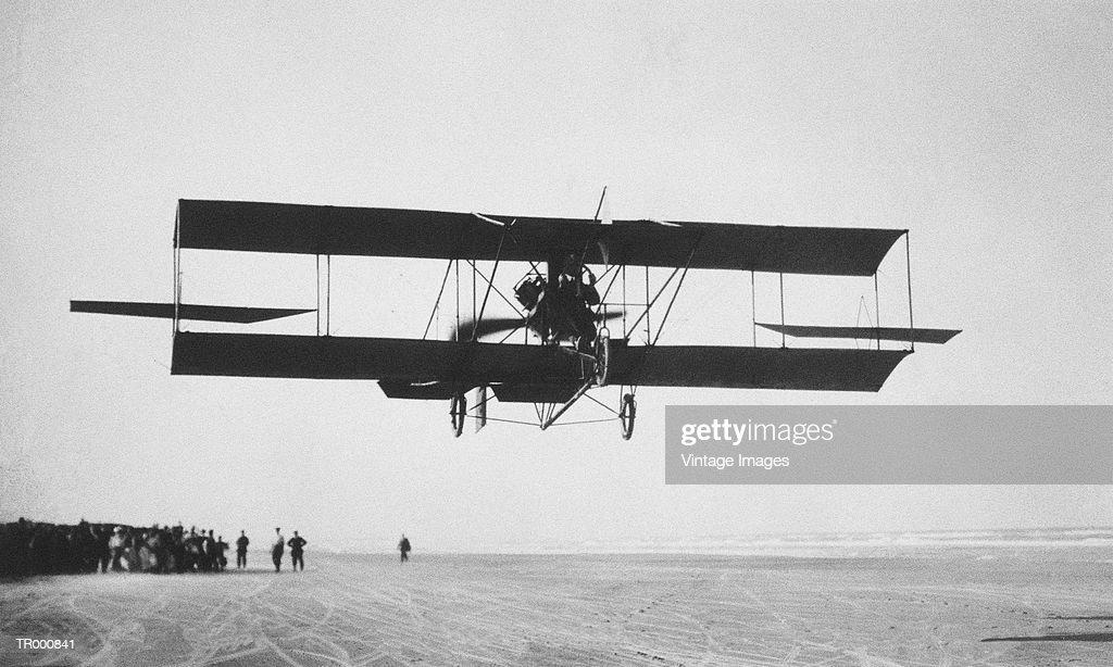 Biplane in flight (B&W)