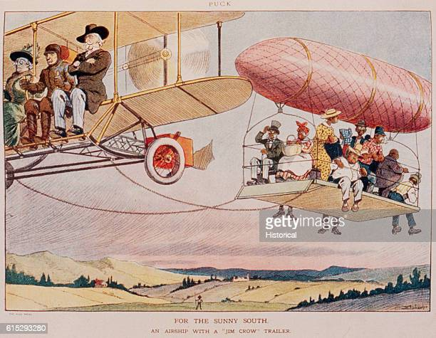 A biplane leads a dirigible with a platform hanging from it The three biplane passengers are white and the platform has several AfricanAmerican...