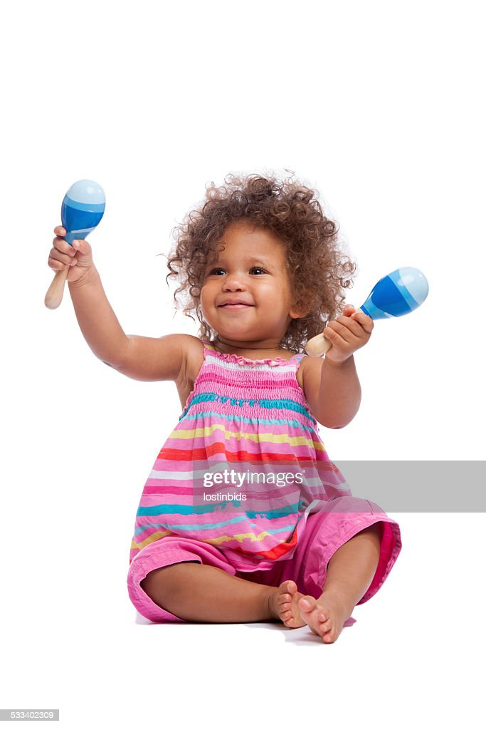 Biracial Baby Girl/ Toddler Waving Her Maracus Isoltated On White : Stock Photo