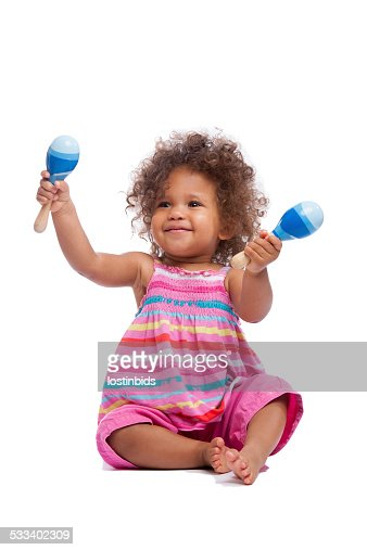 Biracial Baby Girl/ Toddler Waving Her Maracus Isoltated On White