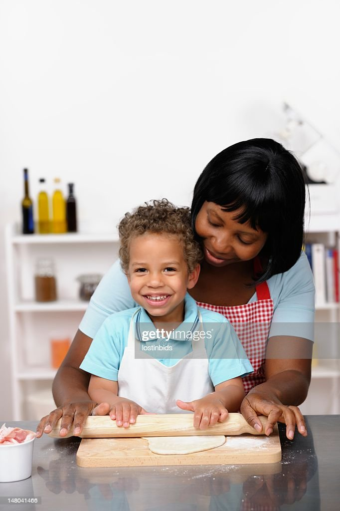Biracial Little Boy/ Toddler Rolling Pizza Dough With His Mother : Stock Photo