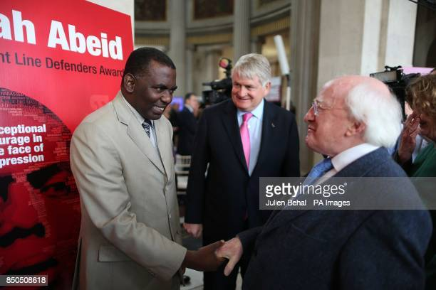 Biram Dah Abeid from Mauritania the winner of the 2013 Front Line Defenders Award for Human Rights Defenders at Risk greets President Michael D...