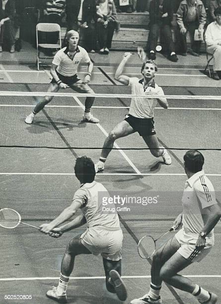 Bird bashing Sweden's Klaus Nordin slams a shuttlecock back at the US pair of Tom Carmichael and Dan Brady in the Canadian Open badminton...