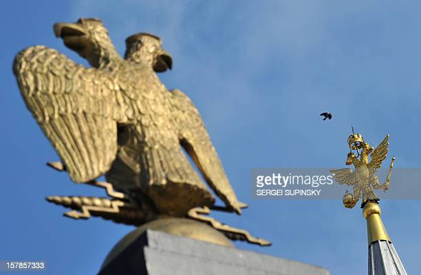 A bird flies near Russian national emblem double headed eagle on top of Historical Museum at the Red Square in Moscow on March 2 2012 Russia on March...