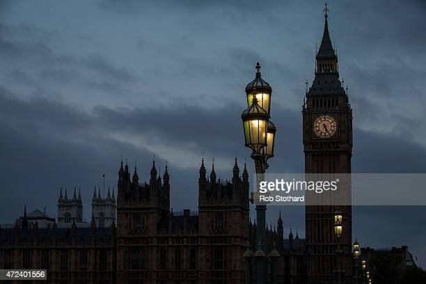 A bird flies over The Houses of Parliament by Big Ben on May 7 2015 in London England The United Kingdom is going to the polls to vote today for a...