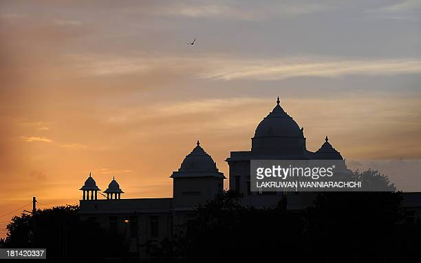 A bird flies over the Jaffna Public Library in Jaffna 400 kilometres north of the capital Colombo on September 21 2013 Sri Lanka's minority Tamils...