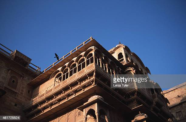 JAISALMERE RAJASTHAN INDIA A bird flies past the medieval carved walls of the Royal Palace in Jaisalmer a forted city on the edge of the Great Thar...