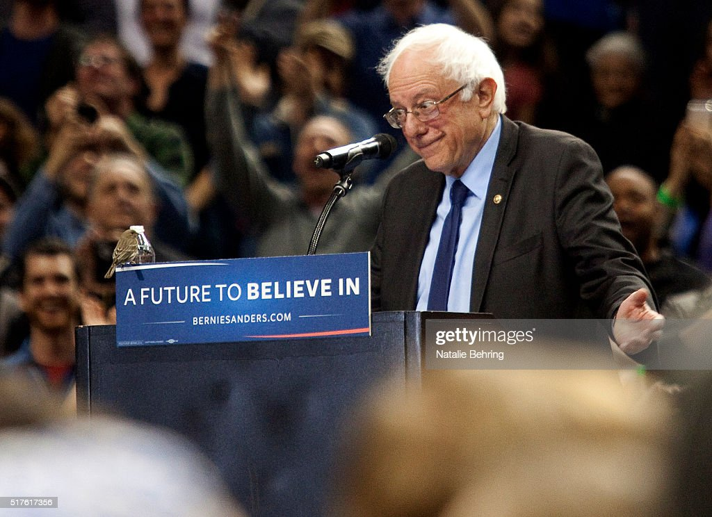 A bird lands on Democratic presidential candidate <a gi-track='captionPersonalityLinkClicked' href=/galleries/search?phrase=Bernie+Sanders&family=editorial&specificpeople=2908340 ng-click='$event.stopPropagation()'>Bernie Sanders</a> podium as he speaks on March 25, 2016 in Portland, Oregon. Sanders spoke to a crowd of more than eleven thousand about a wide range of issues, including getting big money out of politics, his plan to make public colleges and universities tuition-free, combating climate change and ensuring universal health care.