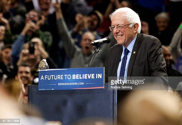 A bird lands on Democratic presidential candidate Bernie Sanders podium as he speaks on March 25 2016 in Portland Oregon Sanders spoke to a crowd of...