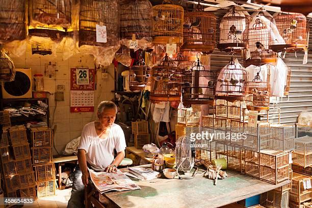 Bird market seller in Mong Kok