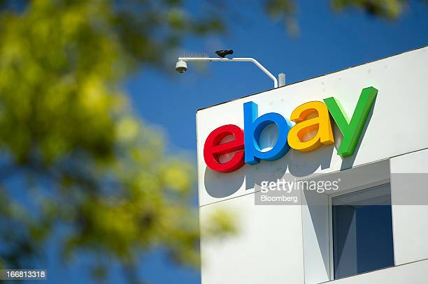 A bird sits over eBay Inc signage displayed on the facade of the company's headquarters in San Jose California US on Tuesday April 16 2013 Ebay Inc...