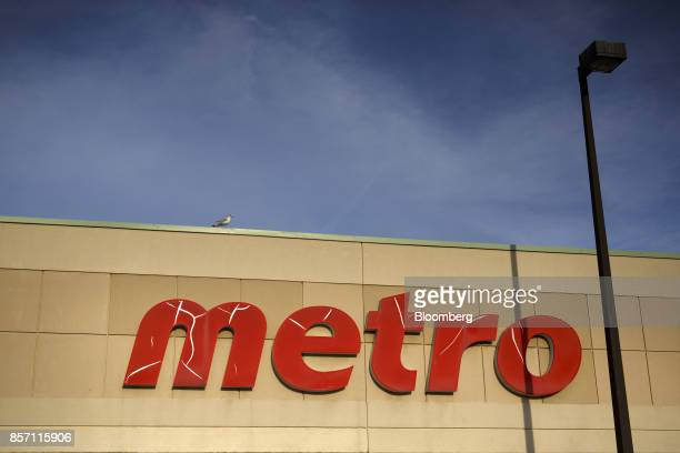 A bird sits perched above signage displayed outside a Metro Inc grocery store in Toronto Ontario Canada on Monday Oct 2 2017 Canadian...