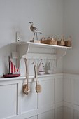 Bird statue and baskets on bathroom shelf,  London