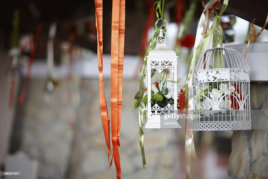 Birdcages decorated with flowers inside, at celebration : Stock Photo