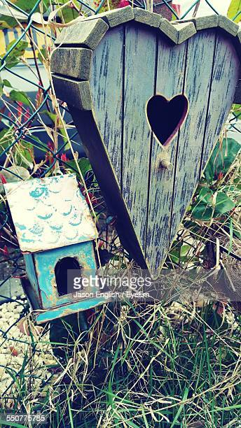 Birdhouses On Chainlink Fence