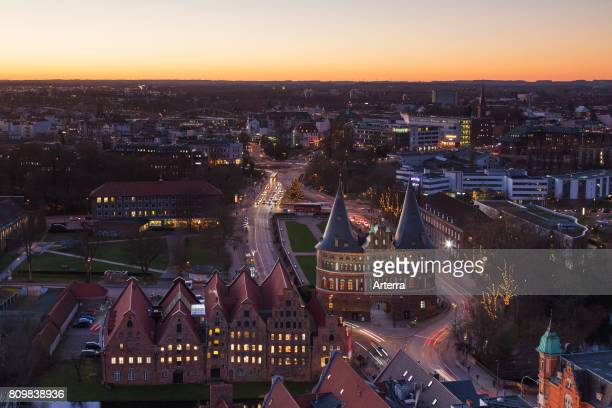 Bird's eye view at dusk over the Holsten Gate / Holstein Tor / Holstentor Brick Gothic city gate at the Hanseatic city of LÙbeck SchleswigHolstein...