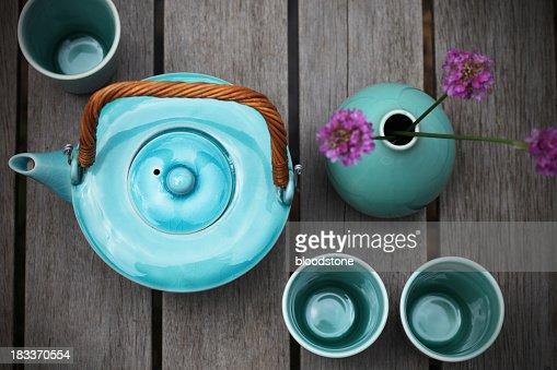 Bird's eye view of a green-blue pottery tea set