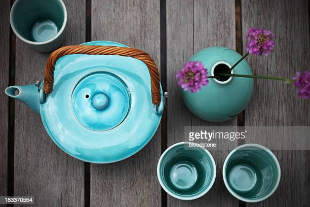 Bird's eye view of a green-blue pottery tea set
