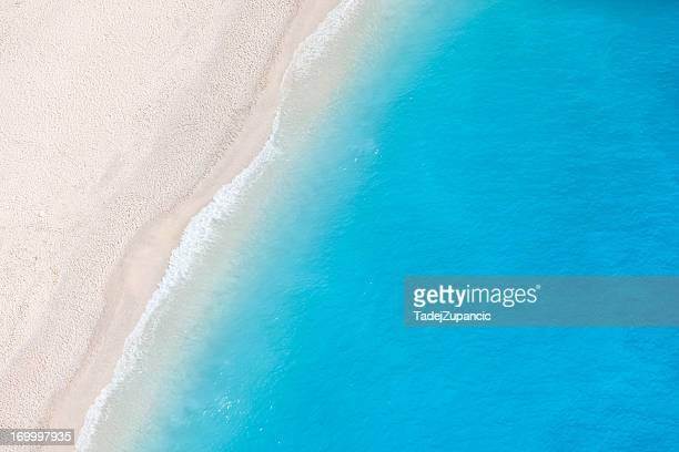 A birds eye view of a white sandy beach