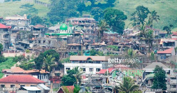 A bird's eye view of destroyed houses after one month of fighting between government troops in Marawi on June 24 2017 Philippine President Rodrigo...