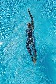 Bird's Eye View of Female Swimmer Swimming Backstroke