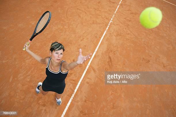 Bird's Eye View of Female Tennis Player Serving