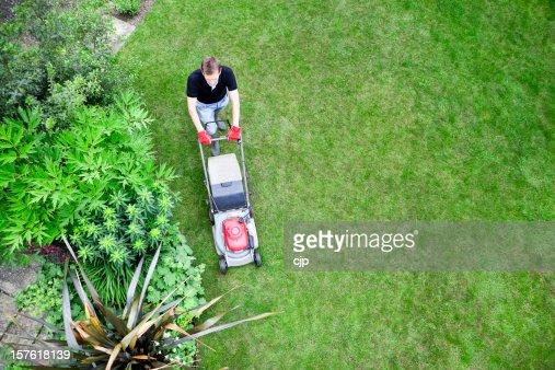 Bird's Eye View of Gardener Mowing Lawn
