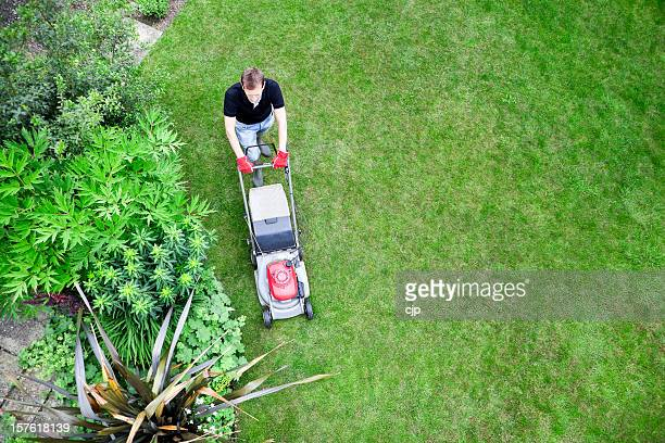 Bird's Eye View of Gardener Mowing Lawn