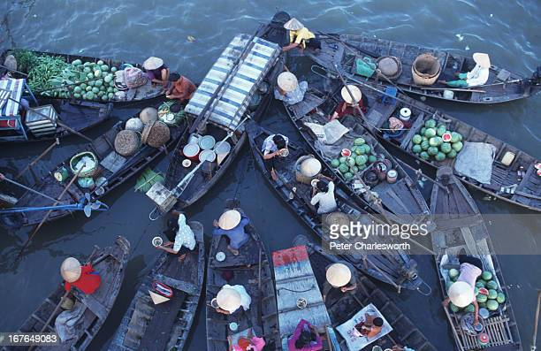 A bird's eye view of the floating market from a high bridge that crosses the main river near Can Tho