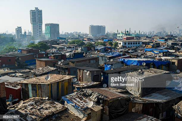 Birds eye view out of a high building down to the roofs of Dharavi Slum the second largest slum area in Asia