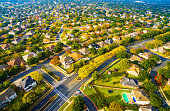 Above Autumn Colors Aerial on Suburbs Homes in Austin , Texas. Looking down Birds Eye View on Suburbia Homes in Austin , Texas a Colorful Residential Area in Fall Autumn