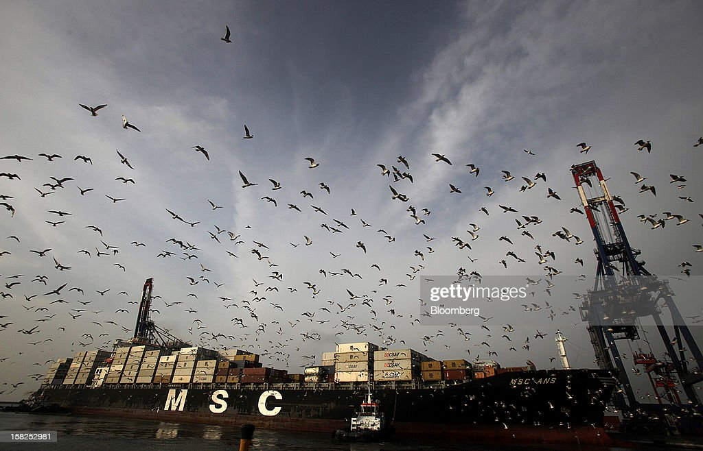 Birds fly above a freighter as it is towed to the docks at the APM Terminals BV area of the Port of Callao in Lima, Peru, on Thursday, March 15, 2012. Economic activity in Peru expanded 5.4 percent from a year earlier, compared with 6 percent growth in December, the government's statistics agency said today in an e-mailed report. Photographer: Dado Galdieri/Bloomberg via Getty Images
