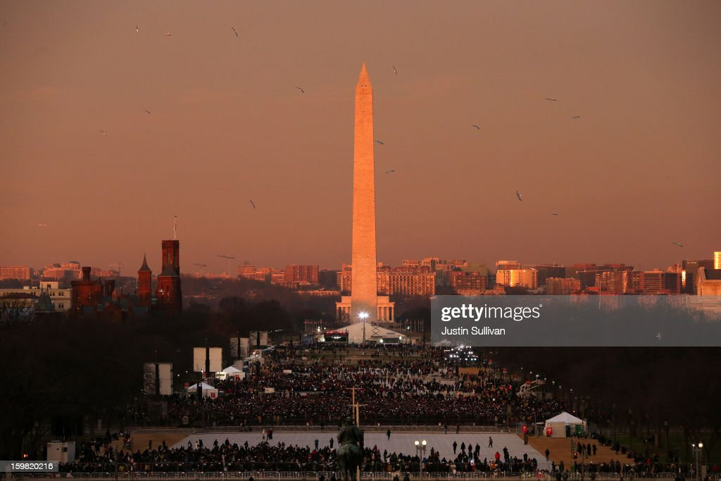 Birds fly over the mall in the early morning in front of the Washington Monument before the presidential inauguration on the West Front of the U.S. Capitol January 21, 2013 in Washington, DC. Barack Obama was re-elected for a second term as President of the United States.