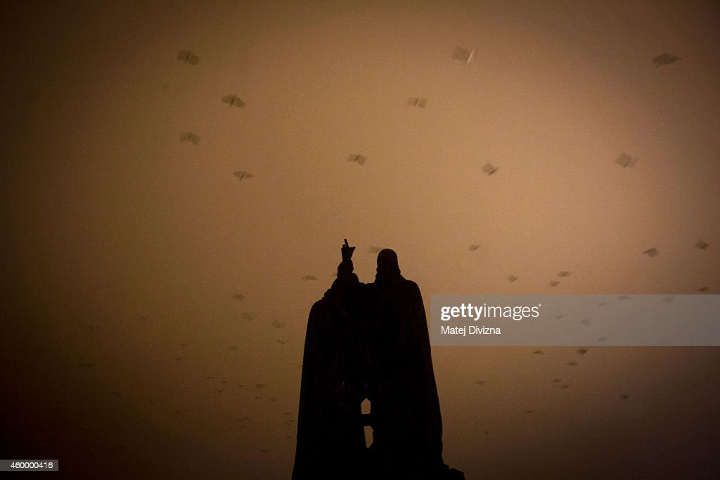 Birds fly over the statue on the Charles Bridge on December 5, 2014 in Prague, Czech Republic.
