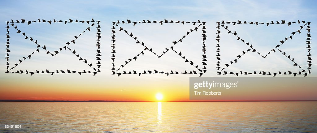 Birds flying in email envelope formations : Stock Photo