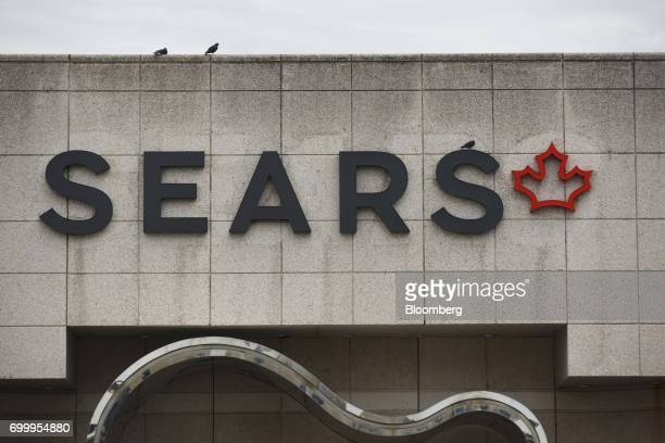 Birds sit above Sears Canada Inc signage displayed at a mall in Toronto Ontario Canada on Thursday June 22 2017 Canadian retailer Sears Canada Inc is...