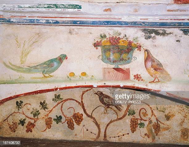 Birds with fruit cup and bird on a vine detail of a fresco in the Catacombs of San Sebastiano Rome Italy 1st4th century