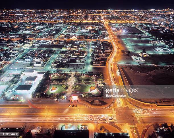 Bird's-eye view of an illuminated Dubai at night.