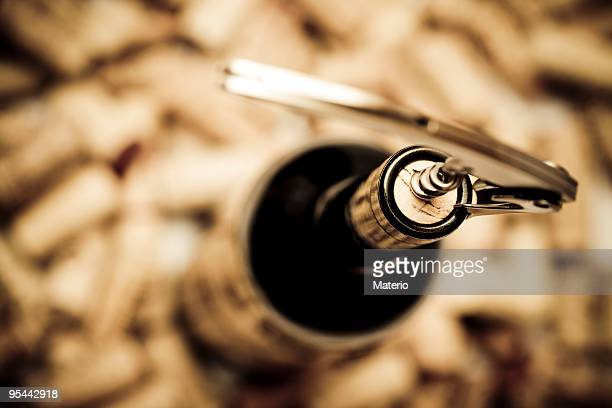 Birdseye view of corkscrew in cork of wine bottle