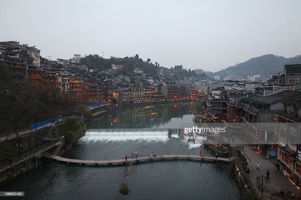 A birdview is from a highway bridge on December 18, 2012 in Fenghuang, China. Fenghuang Town was built by Emperor Kangxi in 1704 and after 300 years, the city's ancient appearance has been well preserved. Hunan is located in southwest Hunan Provience of China with a population of 370,000 within a total area of 1700 square kilometers.