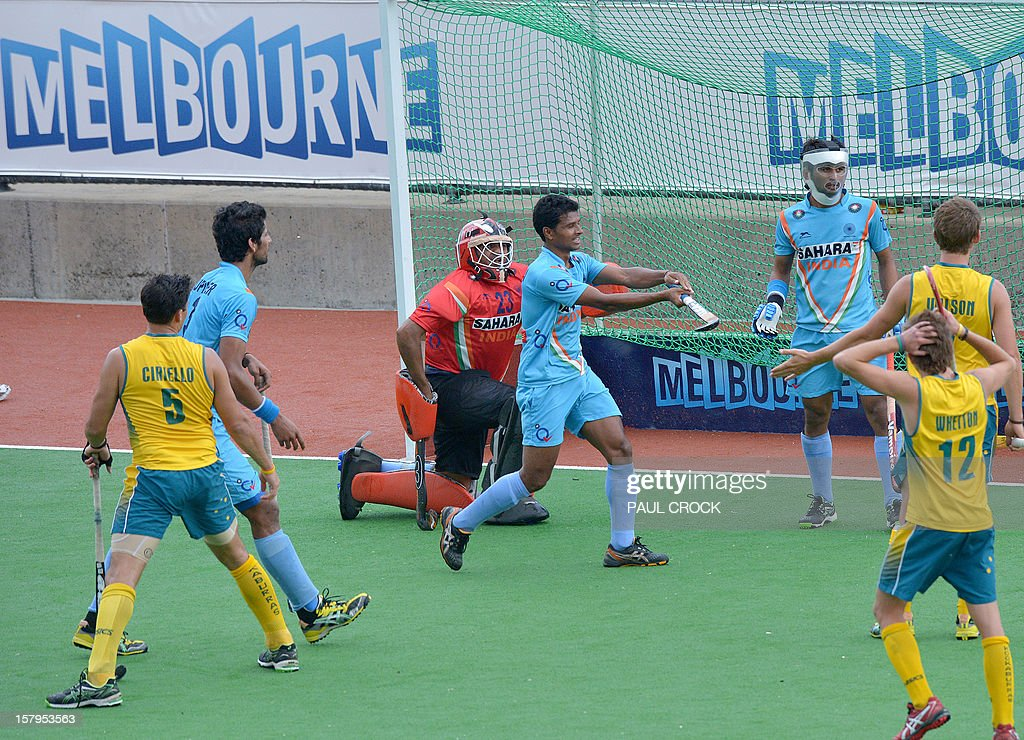 Birendra Lakra Singh of India (C) complains to the umpire that the ball came off his stick after Australia were awarded a penalty corner during the second semi-final at the men's Hockey Champions Trophy tournament in Melbourne on December 8, 2012. IMAGE STRICTLY RESTRICTED TO EDITORIAL USE - STRICTLY NO COMMERCIAL USE AFP PHOTO / Paul CROCK