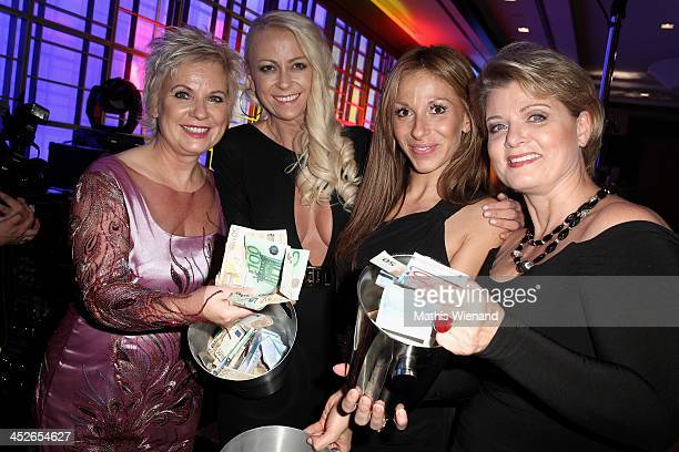 Birgit Lechtermann Jenny Elvers Guelcan Kamps and Andrea Spatzek attend the 'Dolphin's Night 2013' at InterContinental Hotel on November 30 2013 in...